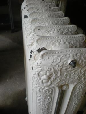 Peeling paint makes these otherwise beautiful radiators look bad.
