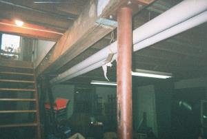 Copper mains run on other side of girder.