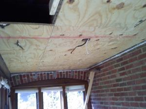 Plywood put up on the ceiling joists.
